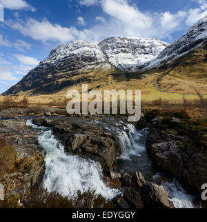 The river Coe with the cliffs of the Aonach Dubh buttress in the background - Stock Photo