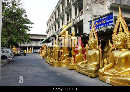 Buddha golden statues at manufactury on street in Bangkok, Thailand, Southeast Asia. - Stock Photo