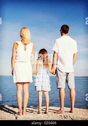 happy family at the seaside - Stock Photo