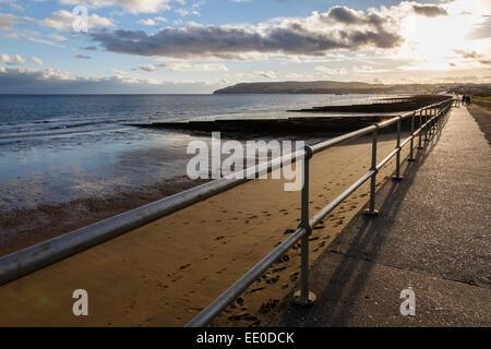 Looking along Culver Parade towards the Esplanade at sunset, Sandown, Isle of Wight - Stock Photo