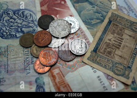 A mixture of old drachma coins and paper notes - Stock Photo