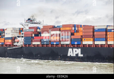 Container ship 'APL Gwangyang' loaded with multi-coloured containers stacked on deck, underway sailing in Southampton - Stock Photo