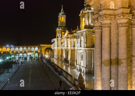 View of the floodlit front facade of the iconic Basilica Cathedral of Arequipa floodlit at night, Plaza de Armas, - Stock Photo