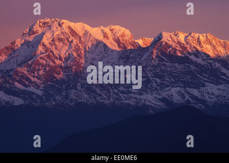 Sunrise over the Dhaulagiri massif of the Annapurna range in the Himalayas - Stock Photo