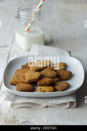 Homemade heart shaped cookies, over white wooden table - Stock Photo