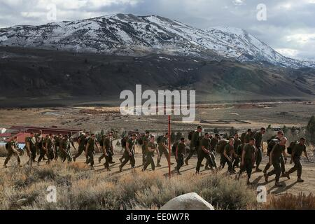 US Marines conduct a 5 mile hike at the Marine Corps Mountain Warfare Training Center January 11, 2015 in Bridgeport, - Stock Photo