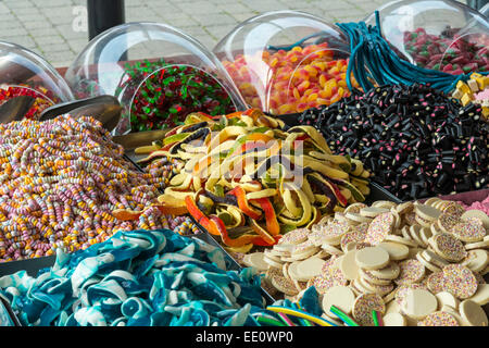 Selection of candy sweets on display for sale. - Stock Photo