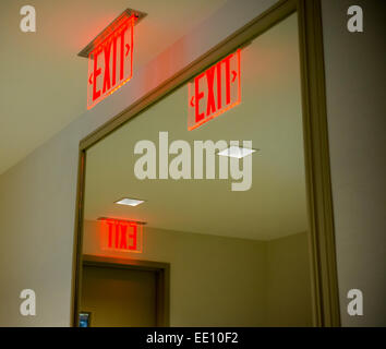 Illuminated exit signs in an apartment building in New York on Sunday, January 11, 2015. (© Richard B. Levine) - Stock Photo