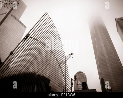 Transportation Hub and the World Trade Center Tower:monochrome. The angled canopy of the Oculus transportation hub - Stock Photo