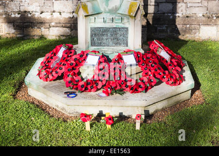 Poppy wreaths for Remembrance Day on the war memorial at St Mildred's Church, Whippingham, Isle of Wight, Hampshire, - Stock Photo