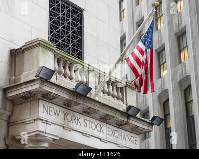 New York Stock Exchange with US Flag. Side entrance to the New York Stock Exchange off Wall Street in Lower Manhattan. - Stock Photo