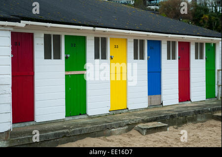 Brightly coloured beach huts on Porthminster Beach, St. Ives in Cornwall,UK - Stock Photo