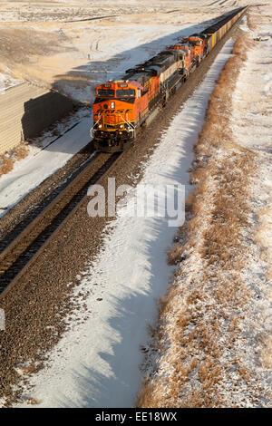 A BNSF line train hauls coal from the Absaloka Mine in eastern Montana, USA - Stock Photo