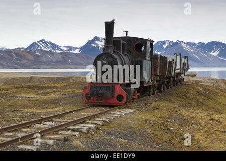 Historic coal mining stream train in tundra, Ny-Alesund, Spitsbergen, Svalbard, August - Stock Photo