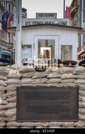 Commemorative plaque, guardhouse, sandbags and uniform caps, Checkpoint Charlie, Mitte, Berlin, Germany, Europe - Stock Photo