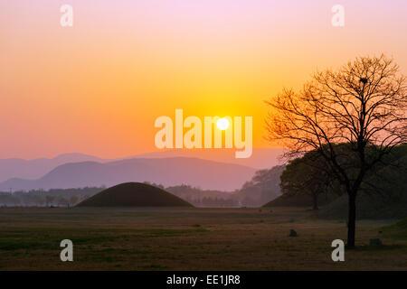 Royal Tombs burial mounds at sunrise, UNESCO World Heritage Site, Gyeongju, Gyeongsangbuk-do, South Korea, Asia - Stock Photo