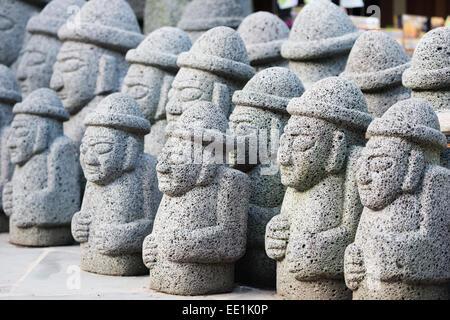 Dol hareubang (harubang) protection and fertility statues, Seogwipo City, Jeju Island, South Korea, Asia - Stock Photo