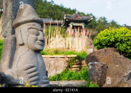 Dol hareubang (harubang) protection and fertility statue at Sanbanggulsa Temple, Jeju Island, South Korea, Asia - Stock Photo