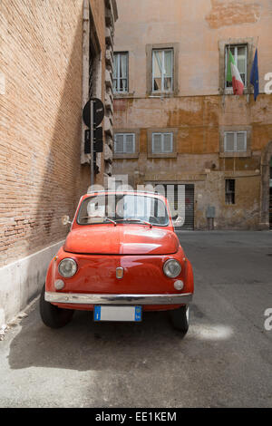 Small old Fiat 500 car parked on a back street in Rome, Lazio, Italy, Europe - Stock Photo