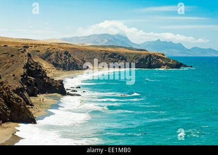 La Pared surf beach and Parque Natural Jandia mountains beyond on the southwest coast, La Pared, Fuerteventura, - Stock Photo
