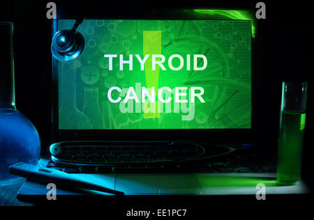 Notebook with words  Thyroid Cancer, test tubes and stethoscope - Stock Photo
