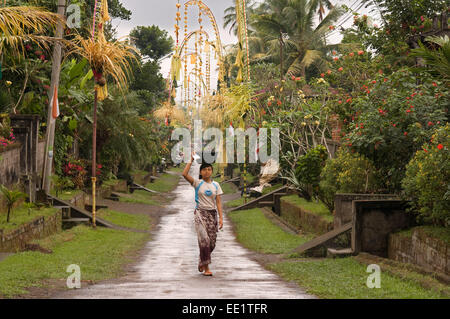 A typical village street near the shrine Tampaksiring Kaki Gunung. Ubud. Bali. Rice field located around the Kaki - Stock Photo