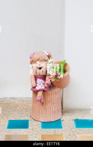 smile baby doll statue in the home - Stock Photo