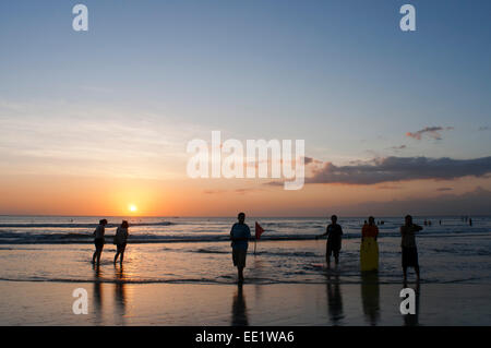 Surfers on the beach of Kuta. Surfing lessons. Bali. Kuta is a coastal town in the south of the island of Lombok - Stock Photo
