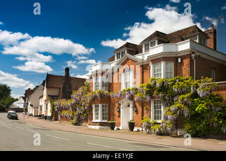 UK England, Suffolk, Lavenham, Church Street, wisteria clad Regency House - Stock Photo