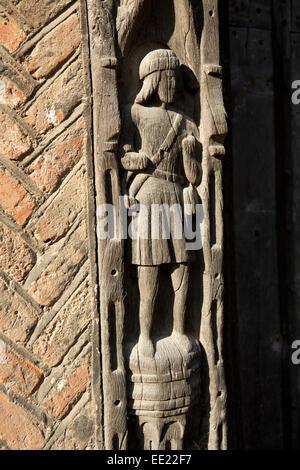 UK England, Suffolk, Lavenham, Water Street, De Vere House, carved medieval figure in door frame - Stock Photo