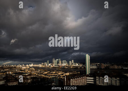 London, UK. 13th Jan, 2015.  Storm clouds over Canary Wharf buildings  Credit:  Guy Corbishley/Alamy Live News - Stock Photo
