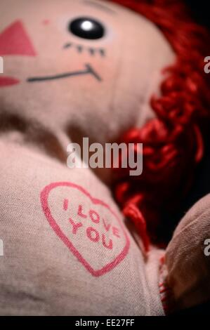 I Love You, close up focus on heart with the words saying I love you on a raggedy ann doll,doll face is out of focus - Stock Photo