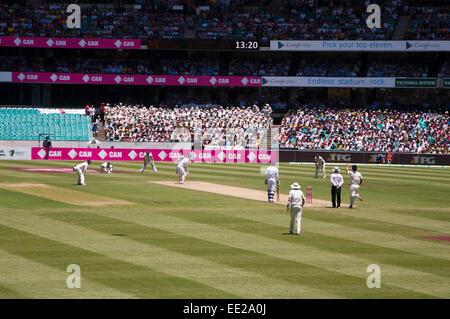 SYDNEY,AUSTRALIA - JANUARY 4: Australias Mitchell Johnson bowls on last Ashes Test match at Sydney Cricket Ground,Australia - Stock Photo