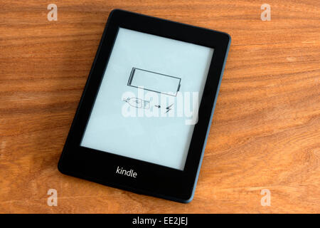 Kindle ebook showing low battery icon - Stock Photo