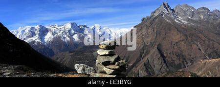 Prayer Stones and Buddhist Stupa on Tengboche Ri Hill, Tengboche village, Everest Base Camp trek, UNESCO World Heritage - Stock Photo