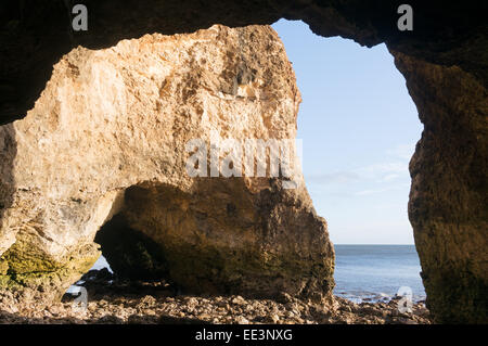 View from within magnesium or magnesian limestone cave at Nose's Point, Seaham, north east England, UK - Stock Photo