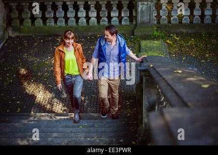 Young couple holding hands, Munich, Bavaria, Germany