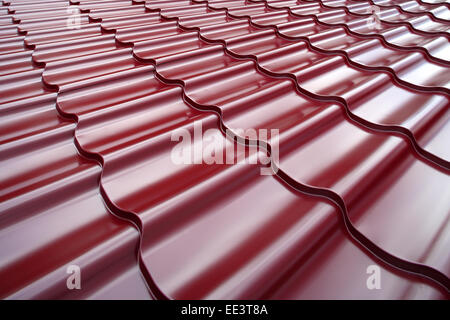 Steel roof painted in red color. steel roof pattern painted red color metal iron construction textured sheet material - Stock Photo