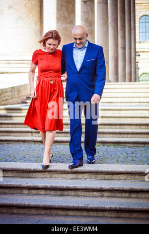 Senior couple walking down staircase, Munich, Bavaria, Germany - Stock Photo