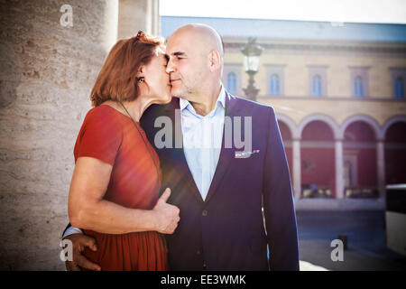 Senior couple kissing tenderly, Munich, Bavaria, Germany - Stock Photo