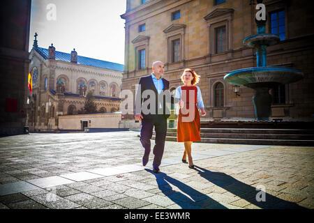 Senior couple walking in town, Munich, Bavaria, Germany