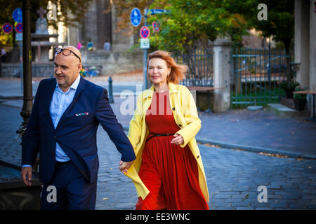 Senior couple walking along street, Munich, Bavaria, Germany - Stock Photo