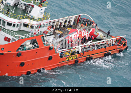 Offshore supply ship the Crest Onyx holds the tail section of Air Asia flight 8501 after recovering the piece from - Stock Photo