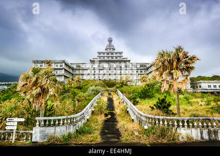 Abandoned hotel building ruins on Hachijojima Island, Japan. - Stock Photo