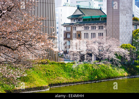 Tokyo, Japan view of buildings around Chidorigafuchi moat in the spring. - Stock Photo