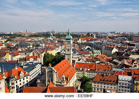 Eastward view of Munich from tower of Peterskirche shows Heilig-Geiste-Kirche and other historic architecture. - Stock Photo