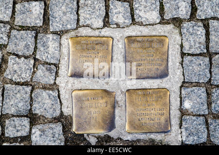 Memorial plaques (Stolpersteine) set into the pavement in Berlin to commemorate the deportation and murder of a - Stock Photo