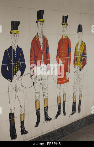 Gentlemen dressed in riding equipment painted on tiles in a underground walkway - Stock Photo