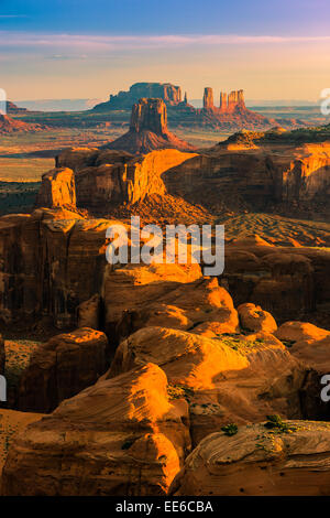 Sunrise with the view from Hunts Mesa in Monument Valley at the border of Utah and Arizona, USA - Stock Photo