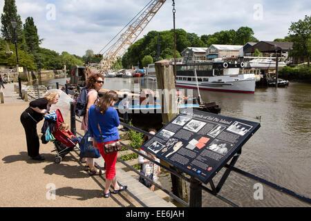 UK, London, Twickenham, visitors on River Thames riverside opposite Eel Pie Island - Stock Photo